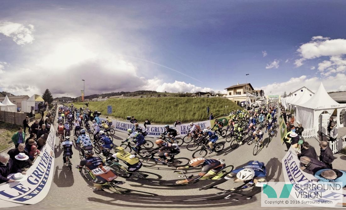 On location on the Tour De France, the pack of cyclists takes a sharp corner, Surround Vision VR 360 degree shoot with GoPro for SKY Sports VR content