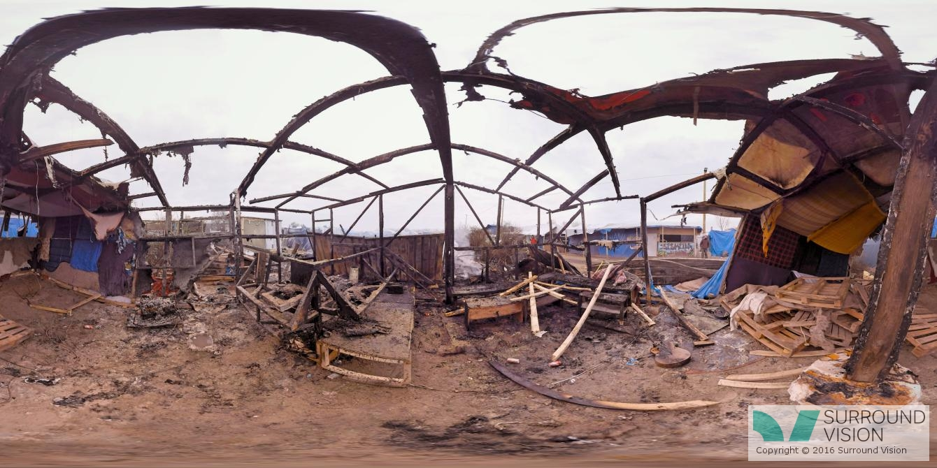 """Burnt out shell of a shanty house at """"The Jungle"""" in Calais France, a depressing scene"""