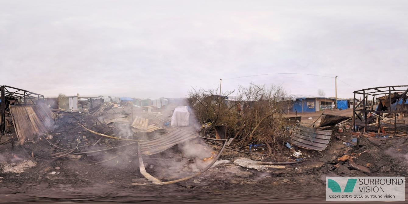 """Fires burn in the squalor at """"The Jungle"""" in Calais France, from the Surround Vison VR production of """"Home: Aamir"""""""