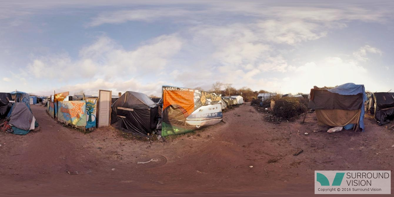 """shanties or shacks, plywood, corrugated metal, sheets of plastic, and cardboard boxes at at """"The Jungle"""" in Calais France, from the Surround Vison VR production of """"Home: Aamir"""""""
